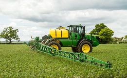 John Deere sprayer spraying in bean field Stock Photography