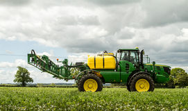 John Deere sprayer spraying in bean field Stock Images