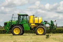 John Deere spraying in bean field Stock Image