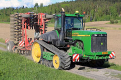 John Deere 9520T Agricultural Crawler Tractor and Cultivator Stock Photos