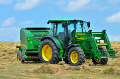 John Deere tractor on the field Royalty Free Stock Photo