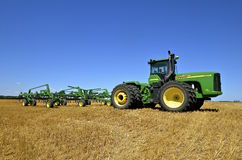 John Deere tractor parked in wheat stubble Stock Images
