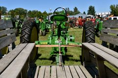 John Deere tractor and people hauler. DALTON, MINNESOTA, Sept 9, 2017: A John Deere tractor hooked to a people hauler are ready for usage at the annual Dalton Stock Photo