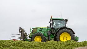 John Deere tractor pushing silage at the clamp Stock Photo