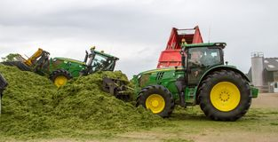 John Deere tractor pushing silage at the clamp Royalty Free Stock Photography