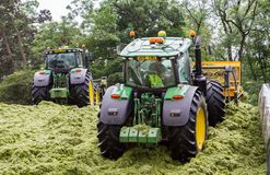 John Deere tractor pushing silage at the clamp Stock Image