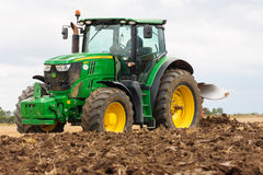 John Deere tractor 6210R working field Stock Images