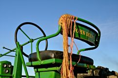 John Deere Tractor Seat. ROLLAG, MN, Sept 1, 2013: Twine hangs from an older John Deere tractor seat which is on display at the West Central Steam Threshers Stock Photo