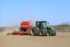 John Deere Tractor and Seed Drill on Spring Field Royalty Free Stock Photography