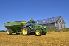 John Deere tractor and trailer full of wheat Stock Images