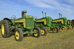 John Deere 830, 730, and 630 tractors. ROLLAG, MINNESOTA, Sept 1. 2016:Vintage John Deere 630, 730, and 830 tractors are displayed at the West Central Steam Royalty Free Stock Photo