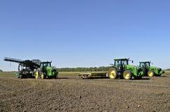 John Deere tractors in sugar beet field Stock Image