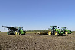 John Deere tractors in sugar beet field. SABIN, MINNESOTA, September 28, 2015 : John Deere tractors and sugar beet lifter parked in a field are products of John Stock Image
