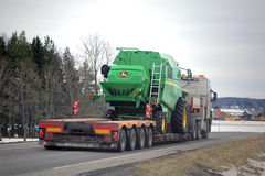 John Deere W330 Compact Combine on Lowboy Trailer Royalty Free Stock Images