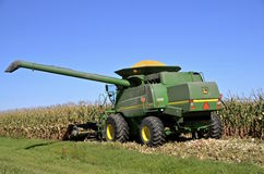 John Deere were self propelled combine harvests corn Royalty Free Stock Photo