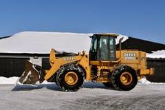 John Deere wiadro dla śnieżnego usunięcia i ciągnik fotografia royalty free