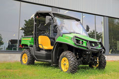 John Deere XUV550 Crossover Utility Vehicle. SALO, FINLAND - AUGUST 9, 2014: John Deere Gator XUV550 Crossover Utility Vehicle on grass. The Gator has a V-twin Stock Images