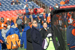 John Elway. Broncos G M John Elway watching his team warm up at Mile High stadium stock photography