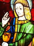 John the Evangelist, stained glass window art Stock Photos