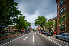 John F. Kennedy Street, at Harvard Square, in Cambridge, Massach Royalty Free Stock Image