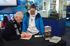 John Furlong and Olympic volunteer. John Furlong signs his book Patriot Hearts for a volunteer. John Furlong, VANOC CEO, of the 2010 Olympic Winter Games Stock Photography