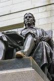 John Harvard Statue. John Harvard monument (c. 1884) by Daniel Chester French (Cambridge, Massachusetts). John Harvard established one of the most famous Stock Images