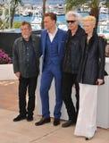 John Hurt & Tom Hiddleston & Jim Jarmusch & Tilda Swinton. CANNES, FRANCE - MAY 25, 2013: John Hurt. Tom Hiddleston, Jim Jarmusch & Tilda Swinton at photocall at Royalty Free Stock Photo