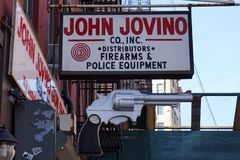John Jovino Gun Shop Sign Photos stock