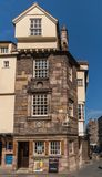 John Knox House, Edinburgh, Scotland, UK. Edinburgh, Scotland, UK - June 13, 2012: Pub and restaurant in John Knox House, a protestant reformer. Golden slogan stock photo
