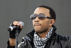 John Legend performs in concert. At the Tailgate 2009 fan zone prior to Super Bowl XLIII featuring the Arizona Cardinals vs. the Pittsburgh Steelers at Raymond royalty free stock photo