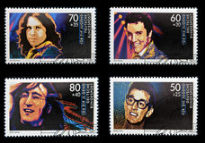John Lennon, Jim Morrison, Elvis Presley and Buddy. Collection stamps printed in Germany dedicated to rock and roll, shows John Lennon, Jim Morrison, Elvis Stock Photos