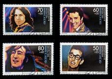 John Lennon, Jim Morrison, Elvis Presley en Vriend Stock Foto's