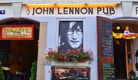 John Lennon pub. The exterior of John Lennon Pub, with an image of famous musician, yellow submarine and other Lennon stuff. Prague, Czech Republic Stock Photos
