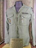 John Lennon's (Beatles) jasje en oogglazen Stock Afbeelding
