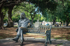 John Lennon Sits on a Park Bench in Havana, Cuba. Statue of John Lennon of The Beatles sitting on a park bench at Lennon Park in Havana, Cuba, in the Vedado Stock Photography