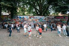 The John Lennon Wall in Prague with unidentified tourists royalty free stock photos