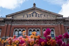 The John Madejski Garden at the Victoria and Albert Museum, London UK. Photo shows facade of Lecture Theatre with flowers in front stock photography