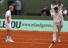 John McEnroe. JUNE 1: Retired tennis legend John McEnroe is angry against the referee and throws his racket while playing tennis at the Roland Garros Open on Stock Photo