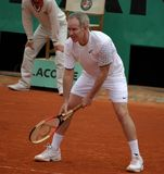 John McEnroe. PARIS - JUNE 1: Retired tennis legend John McEnroe plays tennis at the Roland Garros Open on June 1, 2008 in Paris, France Royalty Free Stock Photos