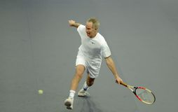 John McEnroe in actions. John McEnroe of the U.S. actions during an exhibition tennis match against Bjorn Borg of Sweden in Kuala Lumpur Stock Images
