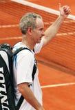 John McEnroe entering a court. USA's legendary tennis player John McEnroe enters Susan Lenglen court of Roland Garros 2007 to play the match of legends Royalty Free Stock Photos