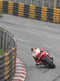 John McGuiness at the 2016 Macau GP on Reservoir Bend. On Honda Fireblade 1000RR motorcycle superbike racer. Black and yellow armco with black tyre lines on Stock Photos