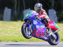 John McGuinness superbike motorcycle racer. John McGuinness is an English superbike motorcycle racer who rides for Honda Europe factory racing team. Here pulling stock photo