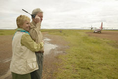 John and Melody Taft making a phone call on Satellite phone in Kenya Africa Royalty Free Stock Photos