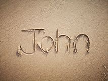 A John name written on the beach. An English John name written on the beach stock photos