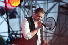 John Newman performs at 'Most festival' on July 3, 2014 in Milnsk, Belarus stock photography