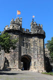 John O`Gaunts Gateway Lancaster Castle flag flying. View of John of Gaunt`s Gateway, the entrance to Lancaster Castle. A flag is flying from the flagpole above Stock Image