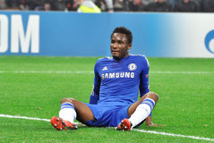 John Obi Mikel is sitting on the field Stock Image