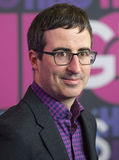 John Oliver. British comedian and television personality John Oliver arrives on the red carpet for the New York premiere of Season 4 of HBO premium cable Stock Image