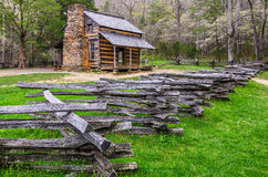 John Oliver Cabin, Cades Cove, Great Smoky Mountains. Springtime at the John Oliver Cabin inCades Cove of the Great Smoky Mountains. A split rail fence leads the stock photo